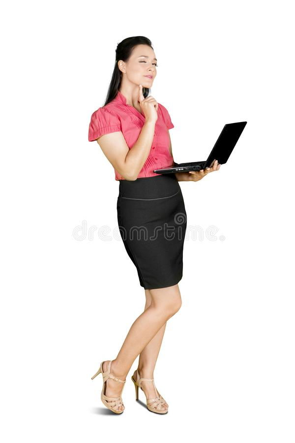Female employee standing in studio with laptop stock images