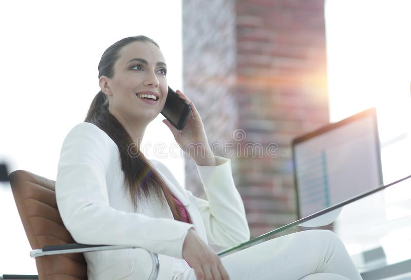Female employee talking on the smartphone royalty free stock images