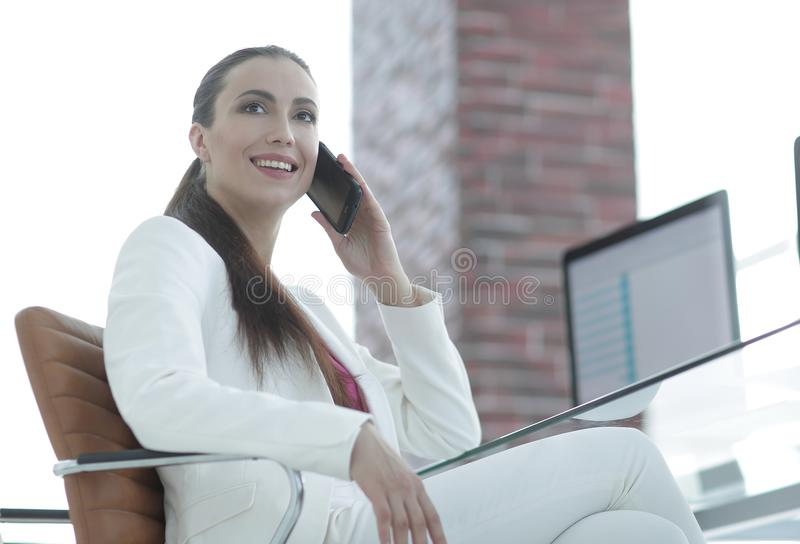 Female employee talking on the smartphone royalty free stock photo