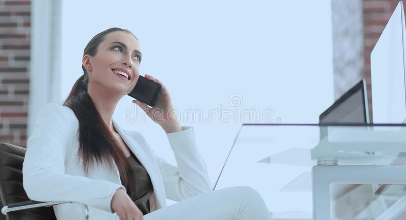 Female employee talking on the smartphone stock photography