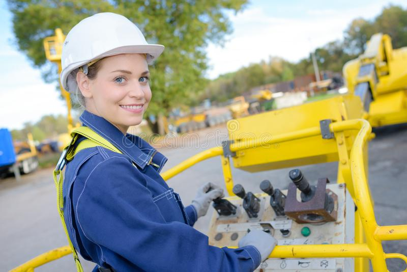 Female engineer crane operator on construction site stock image