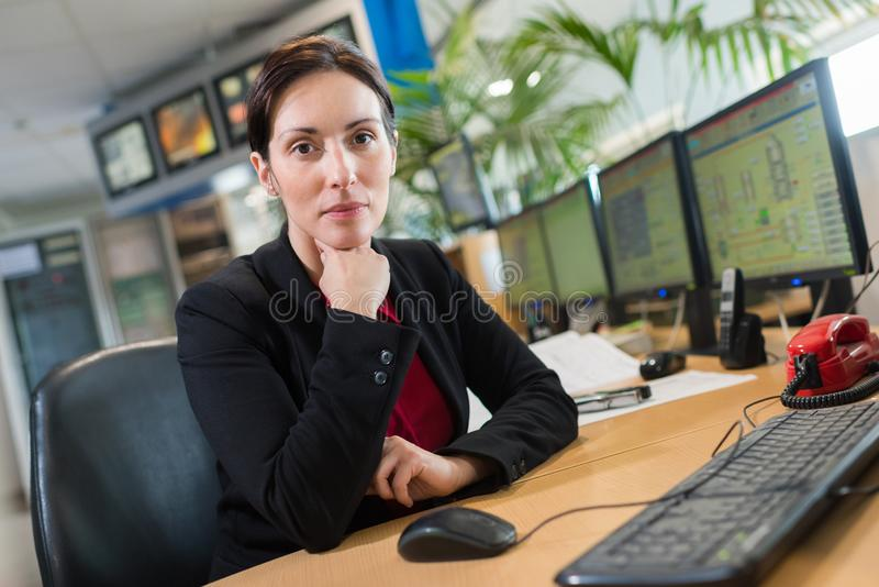 Female engineer in datacenter by network servers stock images