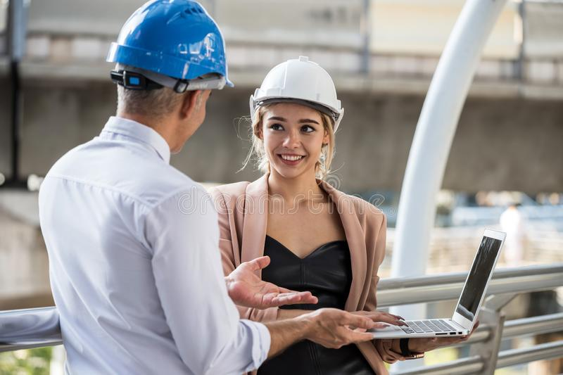 Female engineer discuss construction project with her manager stock image