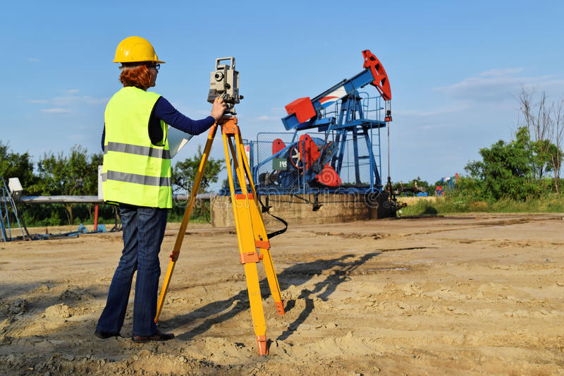 Land surveyor expert at work on an oil well stock images