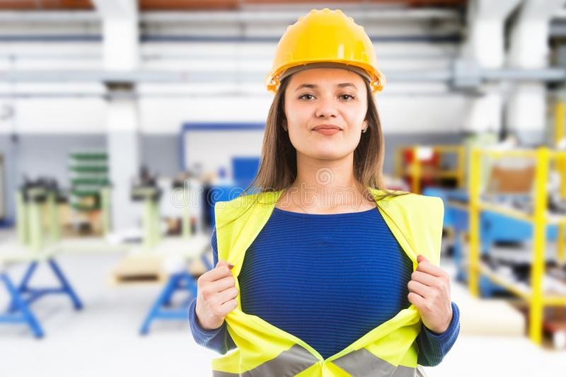 Female engineer making super hero gesture stock photography