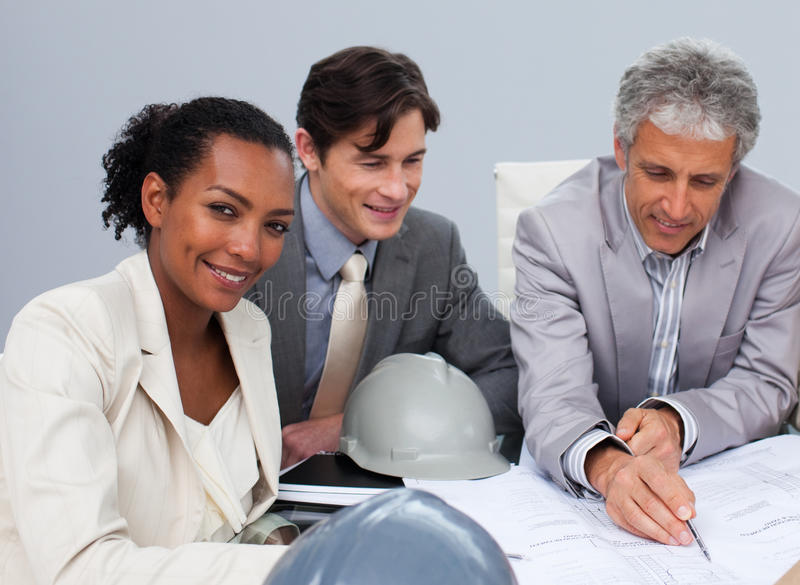 Female Engineer Studying Plans In A Metting Stock Photos