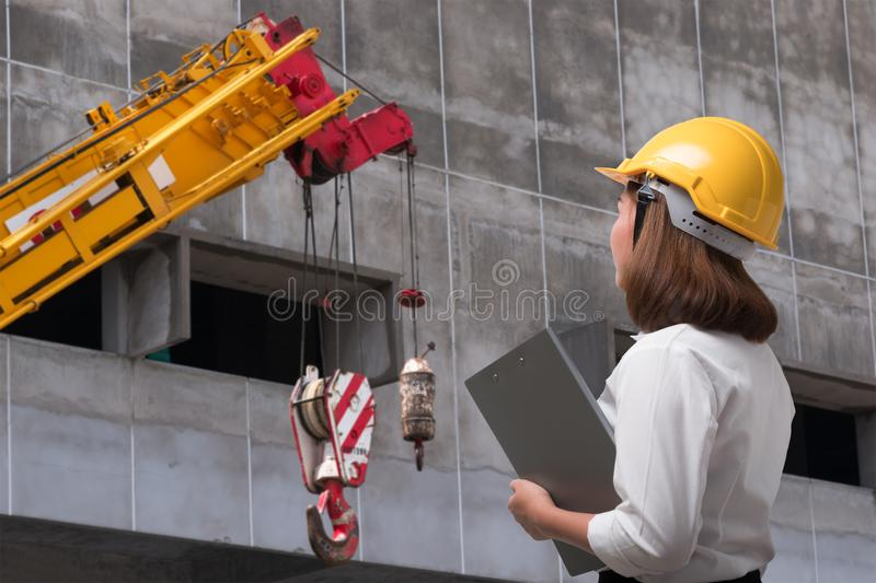 Female engineer wearing safety helmet in construction site stock image
