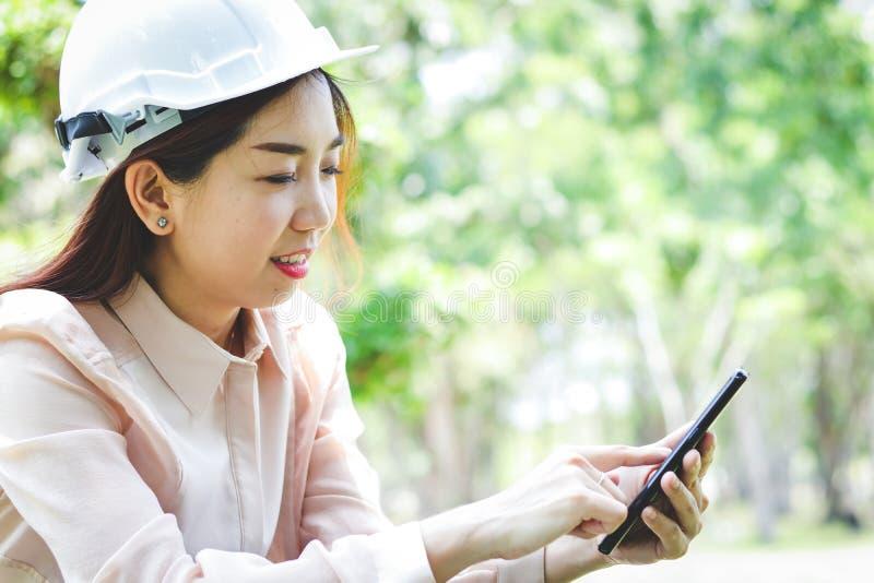 Female engineers pressing mobile phones royalty free stock photo