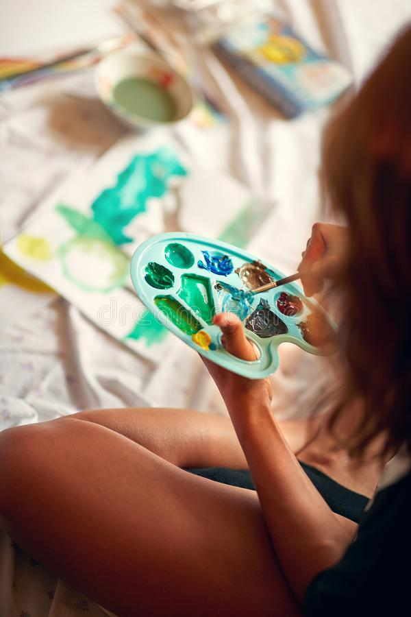 Female painting with temperas royalty free stock images