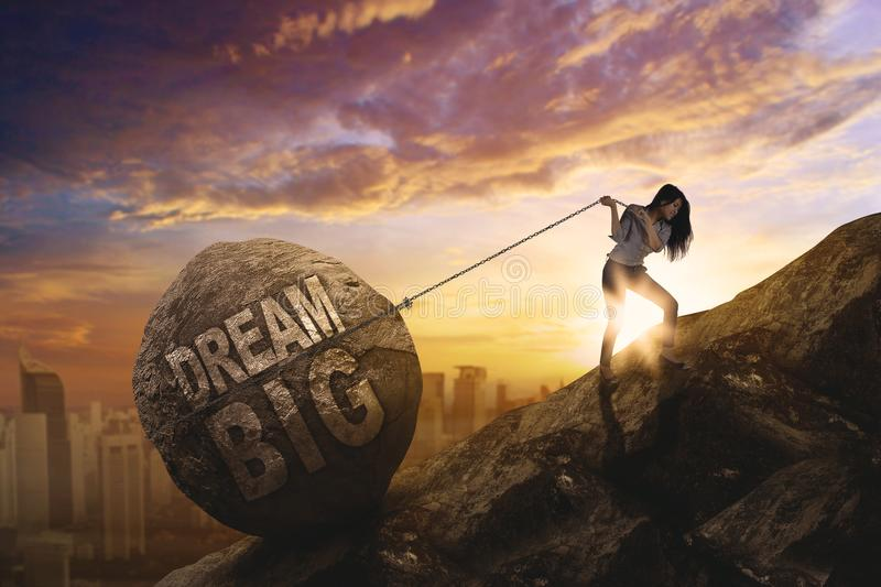 Female entrepreneur dragging text of dream big royalty free stock images