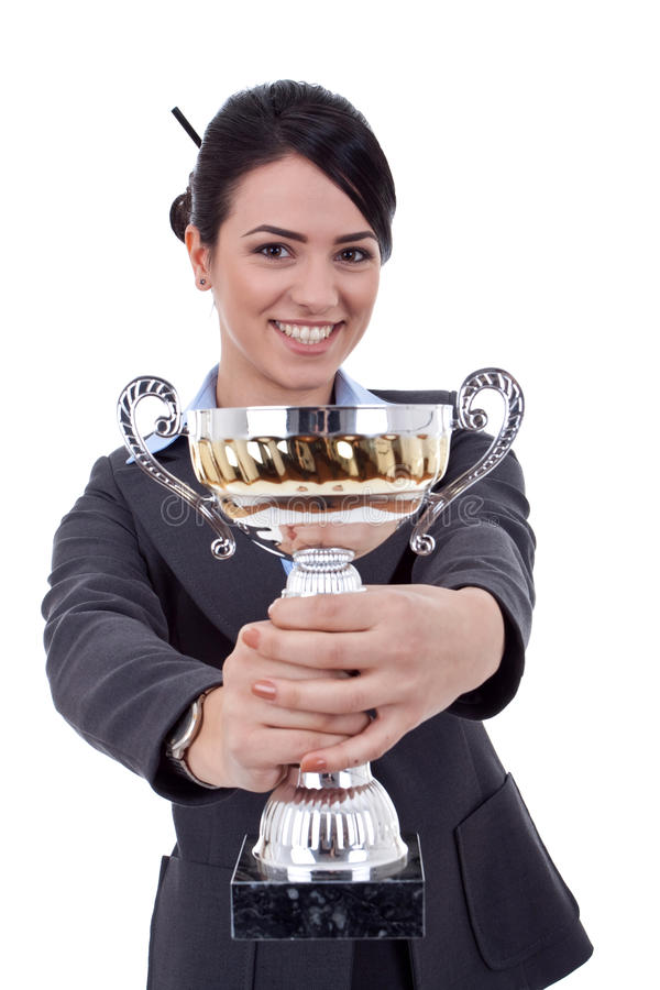 Female entrepreneur holding a trophy royalty free stock photography