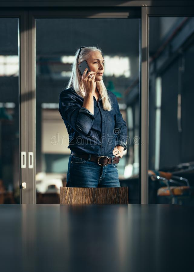 Female entrepreneur making a phone call stock image