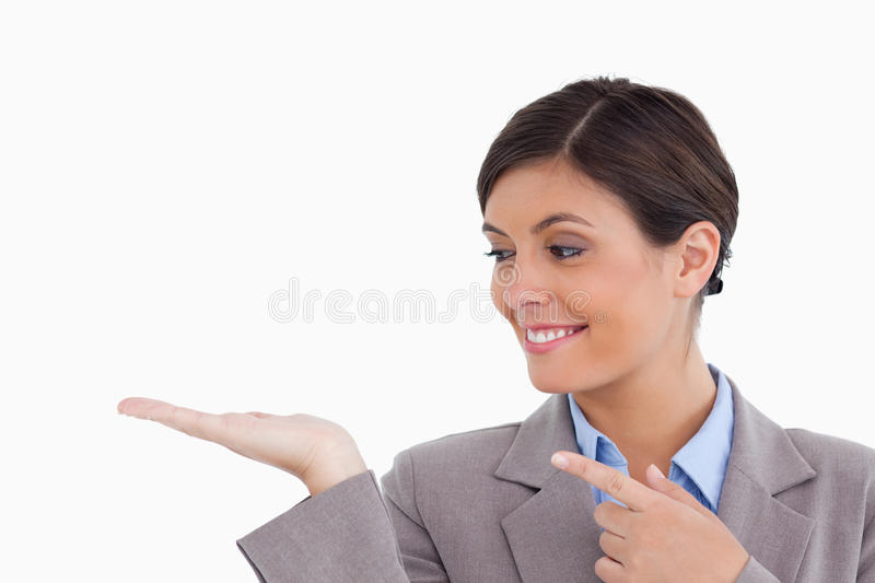 Download Female Entrepreneur Pointing At Her Palm Stock Photo - Image: 23015358