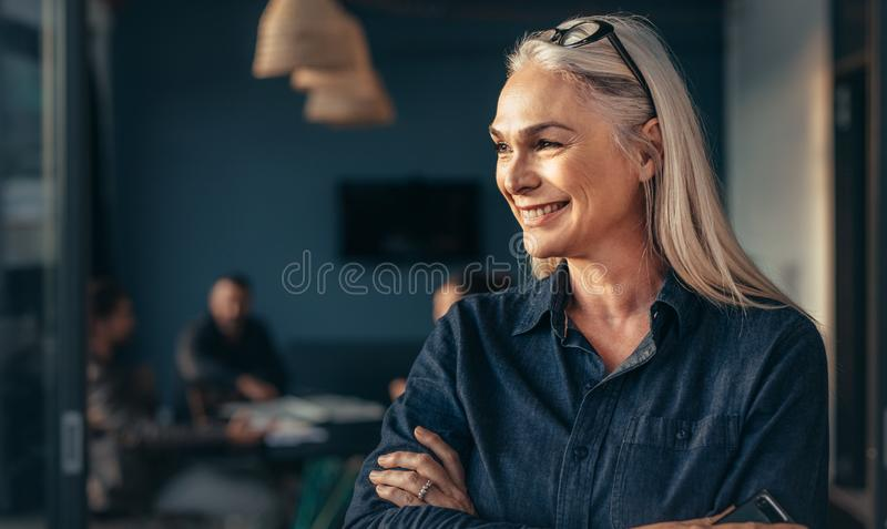 Female entrepreneur standing in office stock photo