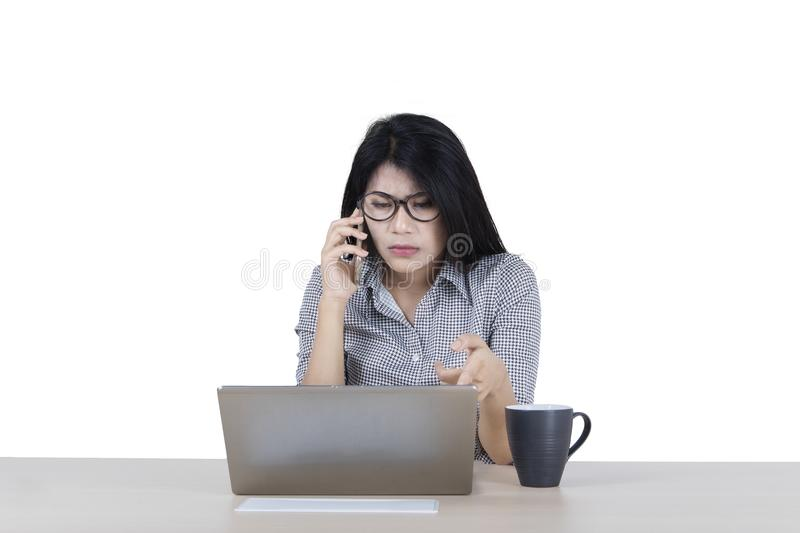 Female entrepreneur with damaged laptop on studio royalty free stock images