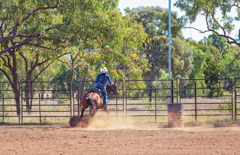 Horse And Rider Competing In Barrel Race At Outback Country Rodeo royalty free stock photos