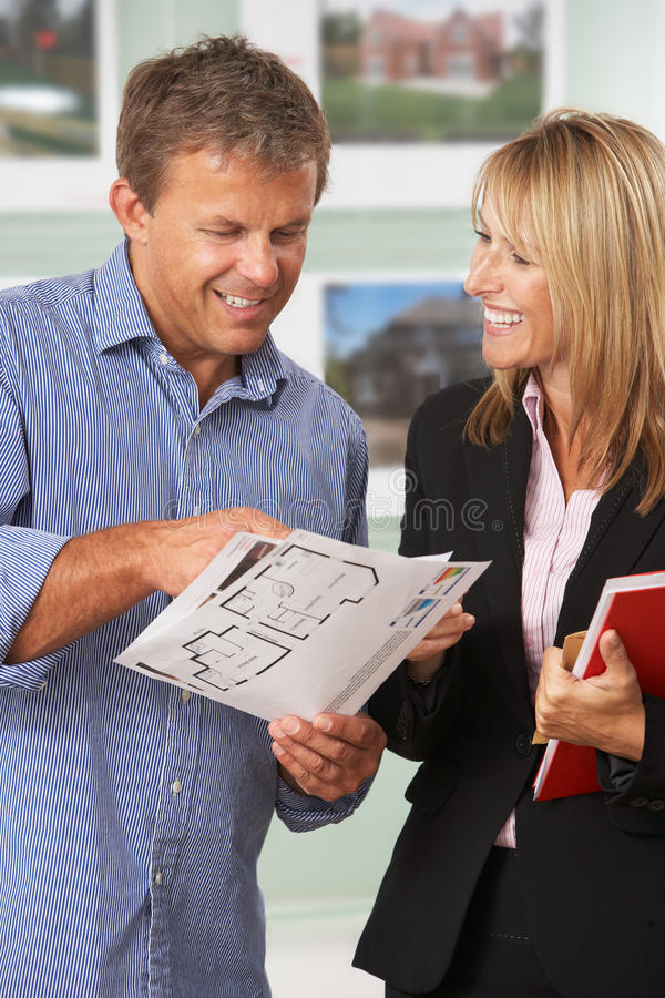 Female Estate Discussing Details With Client. Female Estate Discussing Property Details With Client royalty free stock photo