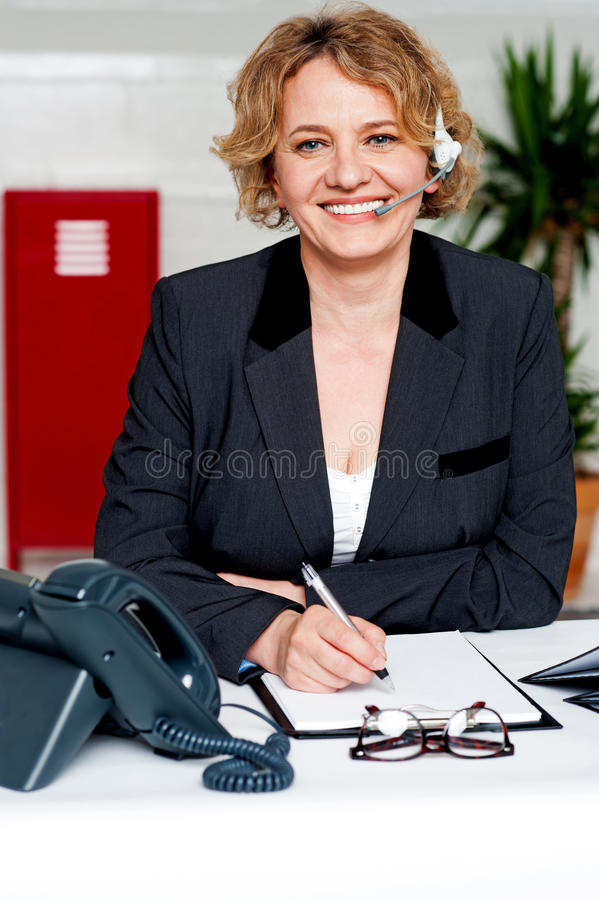 Female executive assisting customers on call