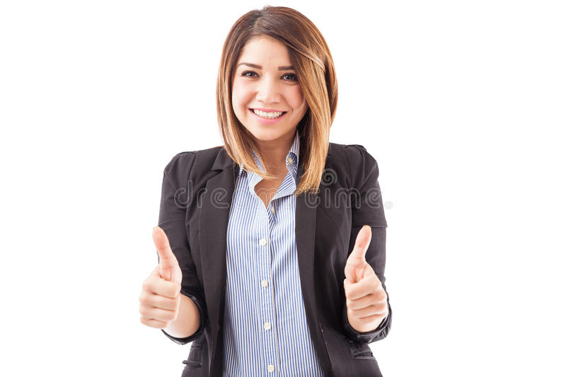 Female executive with both thumbs up stock photography
