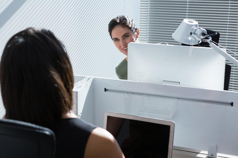 Female executive discussing with each other stock photos
