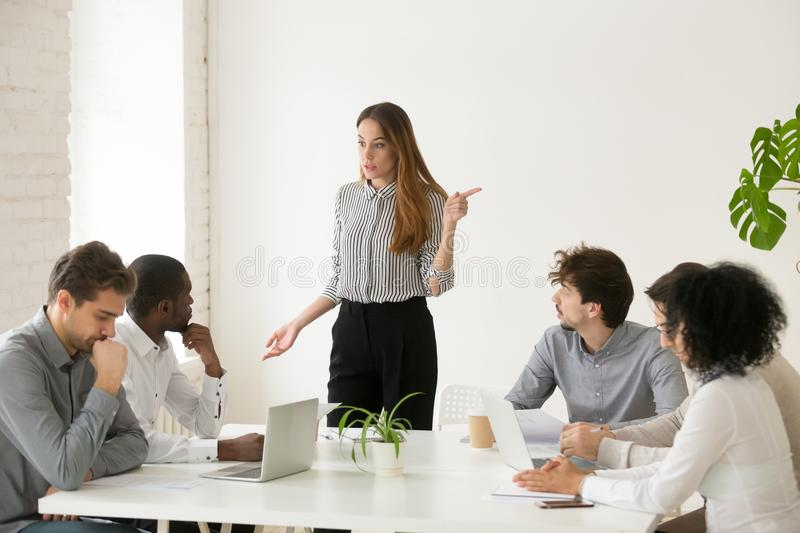 Female executive firing african employee for bad work or miscond stock photos