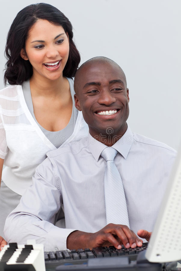 Female Executive Helping Her Colleague Stock Photo