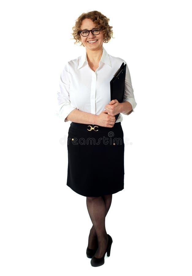 Female executive holding clipboard. Isolated stock image