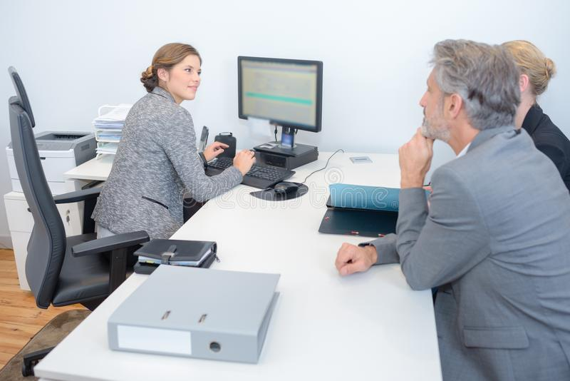 Female executive in meeting with middle aged couple stock photos