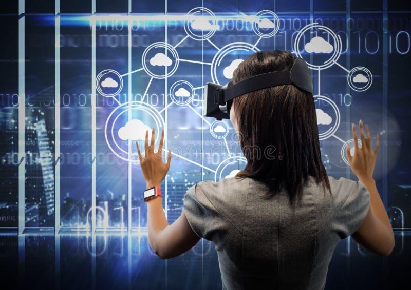 Female executive wearing virtual reality headset stock image
