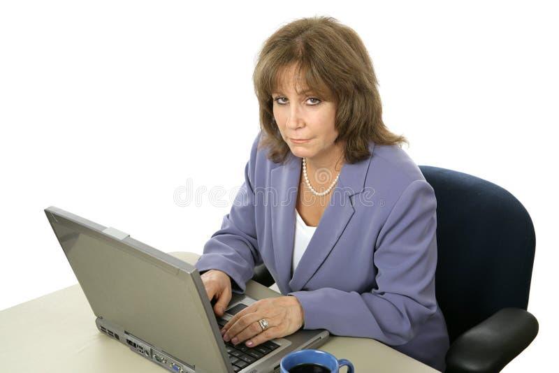 Female Executive Working Late stock photo
