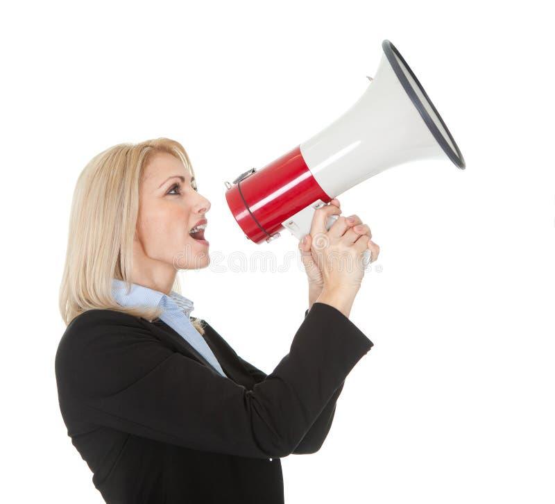 Female executive yelling. Through a megaphone. Isolated on white royalty free stock photography