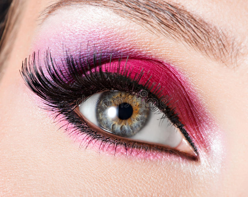 Female eye with beautiful fashion bright pink makeup. Closeup female eye with beautiful fashion bright pink makeup stock photography