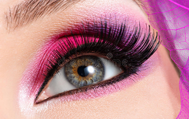 Female eye with beautiful fashion bright pink makeup. Closeup female eye with beautiful fashion bright pink makeup royalty free stock photo