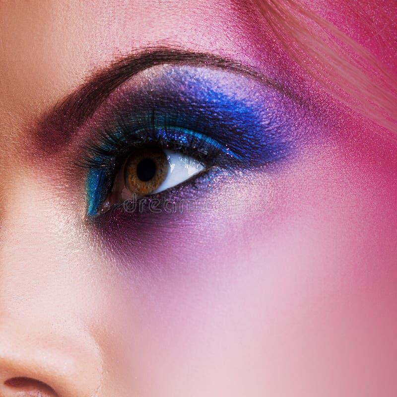 Female eye close-up, creative make-up. Purple tones. Female eye close up, creative make-up. Purple tones royalty free stock image