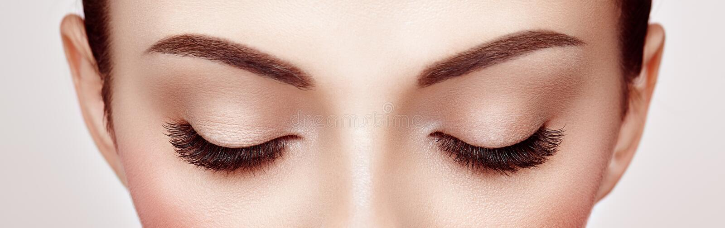 Female eye with long false eyelashes. Female Eye with Extreme Long False Eyelashes. Eyelash Extensions. Makeup, Cosmetics, Beauty. Close up, Macro stock image