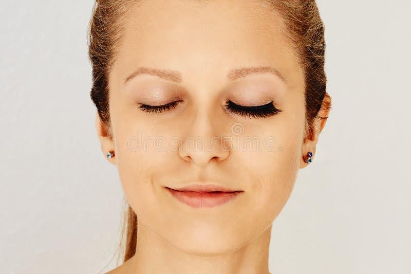 Female eyes with long false eyelashes, befor and after effect. stock photography
