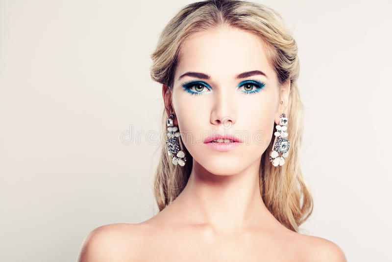 Female Face. Beautiful Fashion Model Woman royalty free stock photos