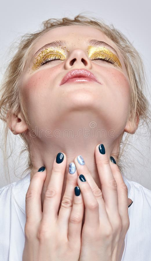 Female face with closed eyes and hands near neck stock photo