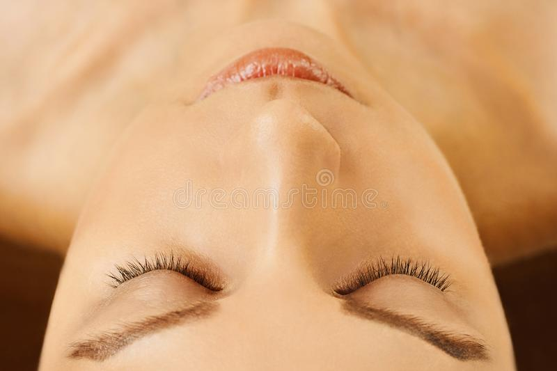 Female face with closed eyes, perfect skin, without make-up royalty free stock image