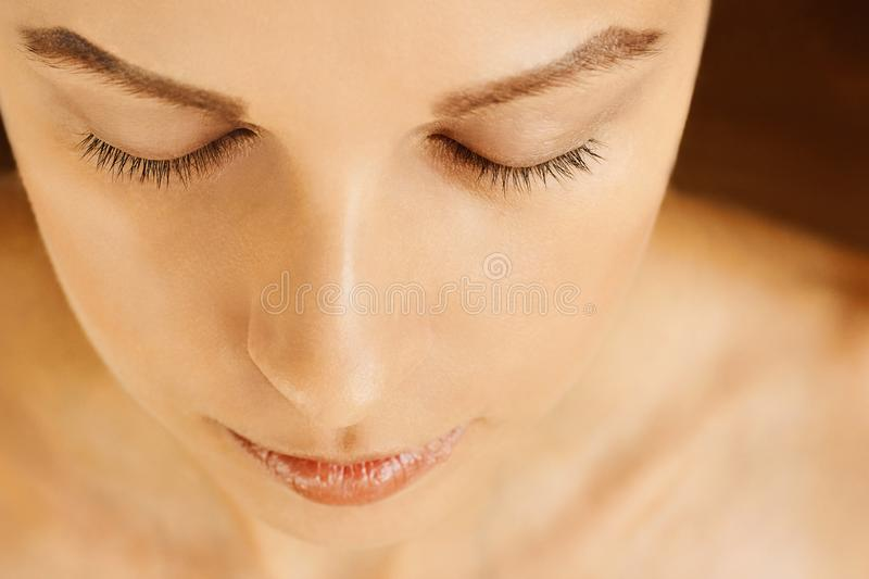 Female face with closed eyes, perfect skin, without make-up stock images