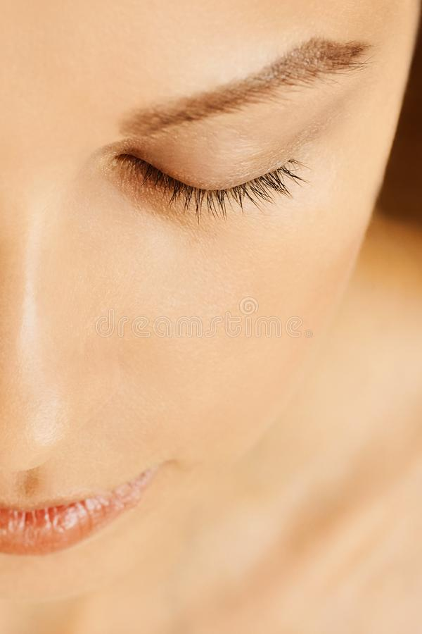 Female face with closed eyes, perfect skin, without make-up royalty free stock images