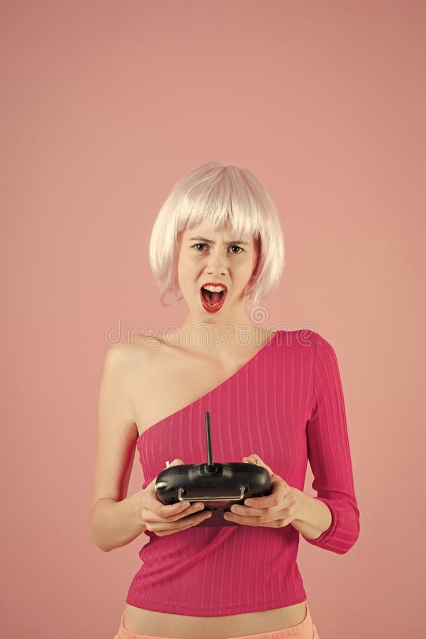 Female Face. Issues affecting girls. woman in wig hair play with game console royalty free stock photo