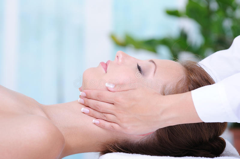Female face massage stock photography