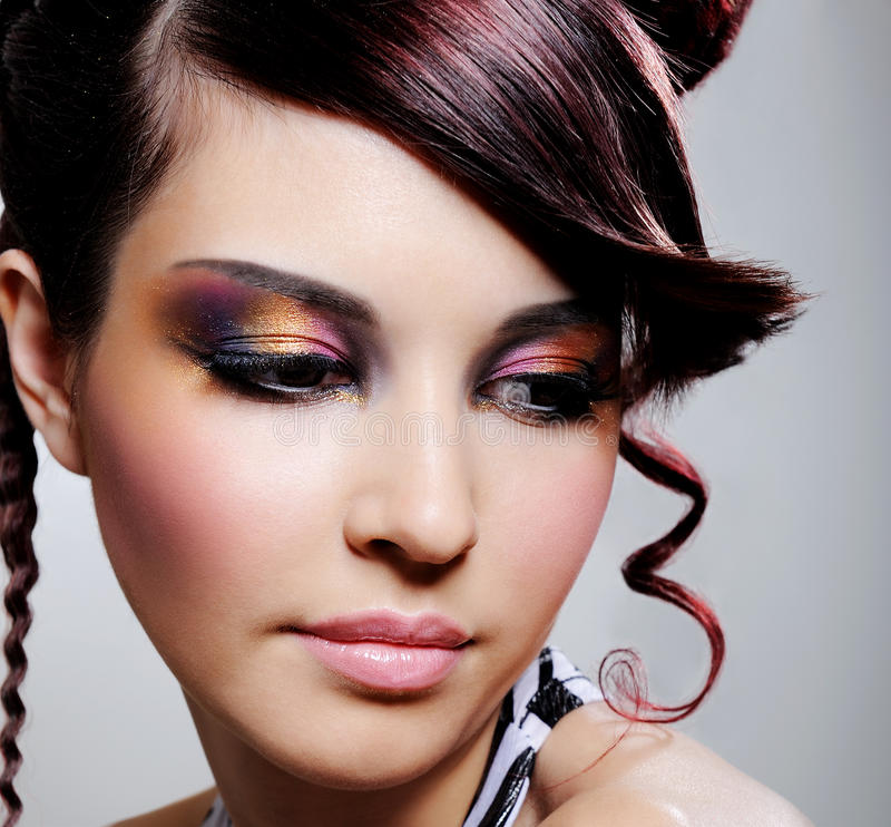 Female face with multicoloured eyeshadow. Beautiful pretty female face with multicoloured eyeshadow - close-up stock photography
