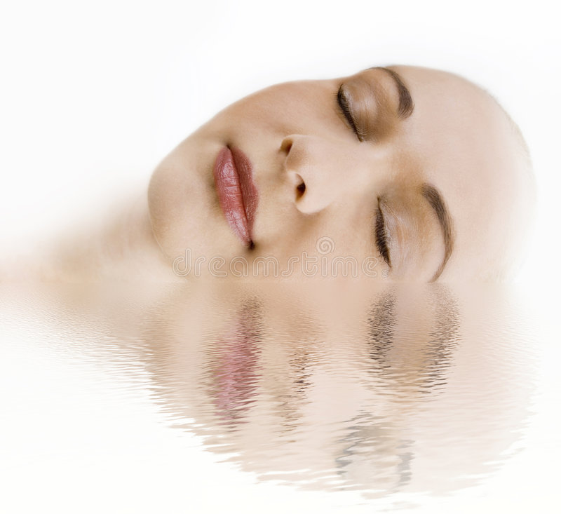 Female face in a water. Water reflection stock photos