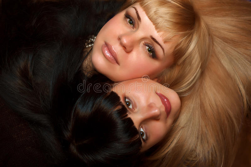Female faces and beautiful hairs royalty free stock photography