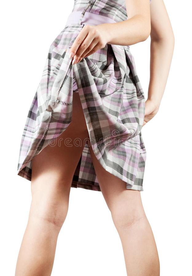 Female fanny in checked skirt royalty free stock photography
