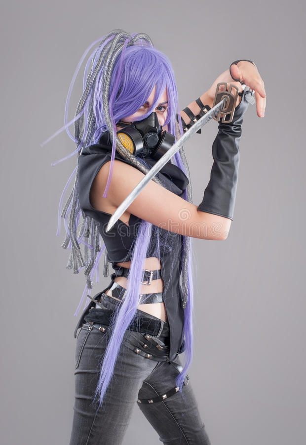 Female fantasy warrior. Female warrior with sword and gas mask isolated on the gray background stock photos