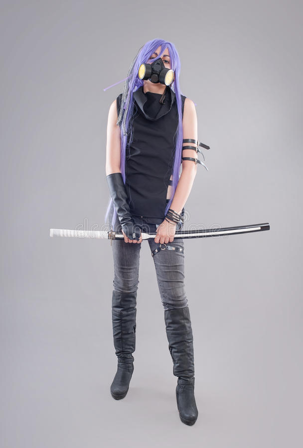 Female fantasy warrior. Female warrior with sword and gas mask isolated on the gray background stock photography