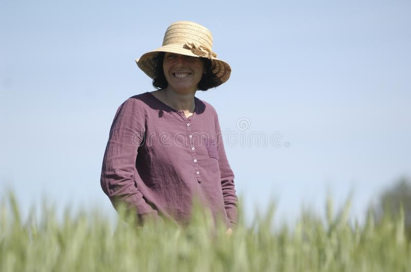 Female farmer in the field royalty free stock photography